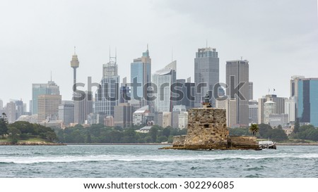 Fort Denison is a historical attraction on Sydney Harbour with a restaurant with harbour and beautiful skyline views - stock photo