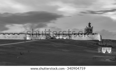 Fort El Morro, which overlooks the Old Town of San Juan, Puerto Rico, at sunset.   - stock photo