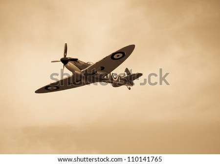 FORT GEORGE, SCOTLAND - AUGUST 11: An unidentified pilot flies a Spitfire plane at the Celebration Of The Centuries event on August 11, 2012 at Fort George, Scotland. - stock photo