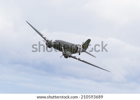 FORT GEORGE, SCOTLAND - AUGUST 9: Douglas C-47 Dakota flying on August 9, 2014 over Fort George, Scotland. Over 10,000 C-47's were built and were used extensively by the Allies in World War 2.