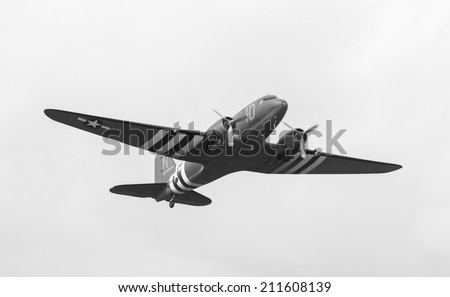 FORT GEORGE, SCOTLAND - AUGUST 9: Douglas C-47 Dakota flying on August 9, 2014 over Fort George, Scotland. Over 10,000 C-47's were built and were used extensively by the Allies in World War 2. - stock photo