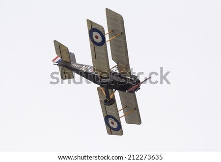FORT GEORGE, SCOTLAND - AUGUST 9: SE5A biplane flying on August 9, 2014 over Fort George, Scotland. SE5's were produced in the first world war and were instrumental in gaining allied air superiority. - stock photo