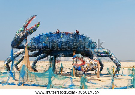 Fort Kochi, India -Jan 7,2015: Mad Crab on beach installation art with Waste Plastics. Plastics and similar non-biodegradable wastes form the most important threat to marine ecosystems in 21st century - stock photo