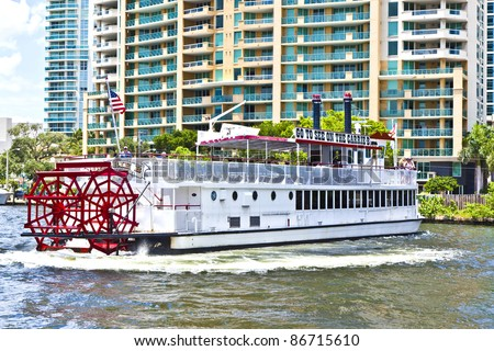 """FORT LAUDERDALE, FL- AUGUST 1: Cruise with """"Carrie B"""" paddlewheel riverboat  on August 1, 2010 in Fort Lauderdale, Florida.  Since 1991, the Carrie B provides sightseeing cruises in Fort lauderdale. - stock photo"""