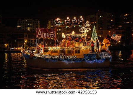 FORT LAUDERDALE, FL - DECEMBER 12: The 2009 Winterfest Boat Parade with grand marshals Alonzo Mourning and Kim Kardashian on December 12, 2009 in Fort Lauderdale, Florida. - stock photo