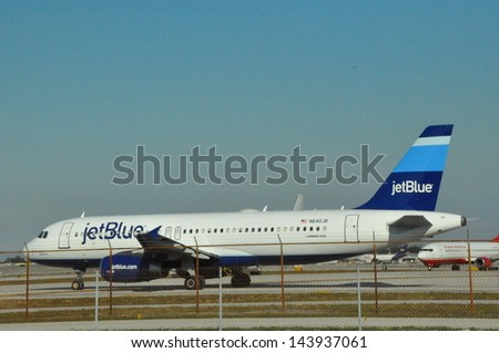 FORT LAUDERDALE, FL - NOVEMBER 25: A JetBlue Airbus at Fort Lauderdale FLL Airport as seen on November 25, 2012.. JetBlue is a low-cost non-union carrier with its base in New York City. - stock photo