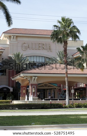Fort Lauderdale, FL, USA - April 30, 2016: Entrance signs to Galleria Mall at Palm Court market entry. Front entrance to the Galleria Mall nearest restaurants.
