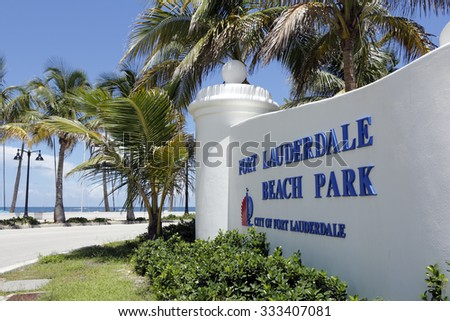 Fort Lauderdale, FL, USA - July 24, 2014: Wide view of Fort Lauderdale Beach Park in large white sign in front of the Atlantic Ocean.South beach in Fort Lauderdale with the most use and amenities. - stock photo