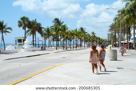FORT LAUDERDALE, FL, USA - June 21, 2014:  Tourist getting ready to spend the first day of summer enjoying the beautiful weather at Fort Lauderdale Beach.   - stock photo