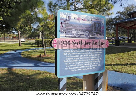 Fort Lauderdale, FL, USA - November 30, 2014: An informational sign about the historic Switcher Engine located in Holiday Park. 1936 Switcher Engine sign in Holiday Park.