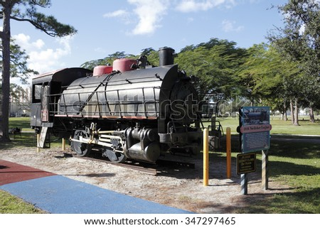 Fort Lauderdale, FL, USA - November 30, 2014: Front side view of an historic locomotive 1936 Switcher Engine and informational sign. 1936 Switcher Engine in Holiday Park.