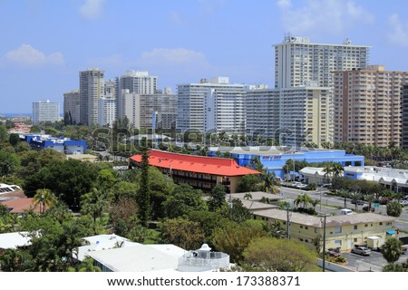 FORT LAUDERDALE, FLORIDA - APRIL 16, 2013: Colorful high up view of high-rise condominiums and other coastal buildings along the shore and inland north of Oakland Park Boulevard on a humid morning.