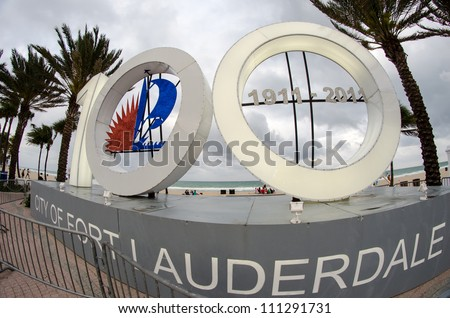FORT LAUDERDALE, FLORIDA - FEB 27: 100 Sign shows city anniversary,with a yearlong celebration of exciting public events, February 27th, 2011 in Fort Lauderdale, Florida - stock photo