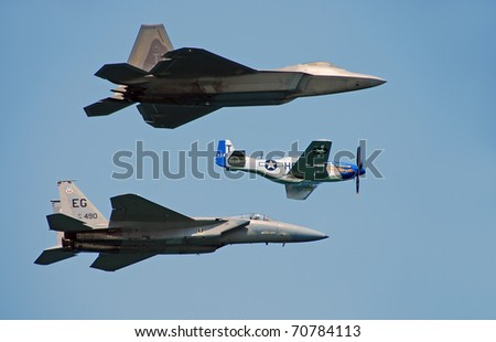 FORT LAUDERDALE, FLORIDA - MAY 5: Three generations of US fighter planes fly at the annual Air and Sea Show. F-22 Raptor, F-15 Eagle and P-51 Mustang flying over Fort Lauderdale, May 5, 2007.