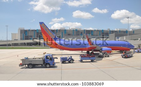 FORT LAUDERDALE, FLORIDA - MAY 27: USA most successful low budget airline Southwest began in 1971 has more than 3,200 domestic flights is preparing plane for takeoff from Ft. Lauderdale May 27, 2012.