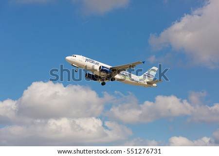 Fort Lauderdale, Florida - USA, January 8, 2016: A Jetblue Airbus A320 with the Bluemanity livery taking off at the Lauderdale/Hollywood International Airport.