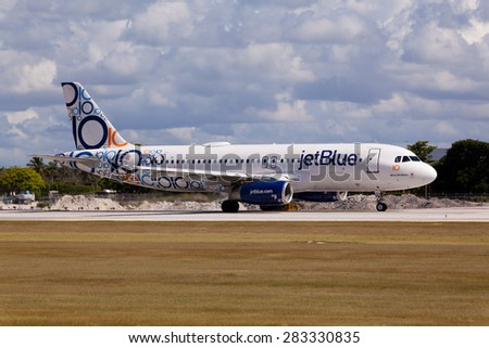 FORT LAUDERDALE, Florida, USA - JUNE 1, 2015: Airbus A320 JetBlue with special 10 years anniversary livery  landing at the Fort Lauderdale/Hollywood International Airport. - stock photo