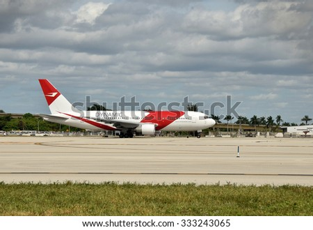 FORT LAUDERDALE - OCTOBER 29: Dynamic Airways Boeing 767 jet caught fire at Fort Lauderdale International Airport. Pictured is the actual aircraft departing for Caracas five days before the accident - stock photo