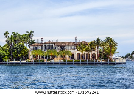 FORT LAUDERDALE, USA - AUG 1: Luxurious waterfront home on Aug 1, 2010 in Fort Lauderdale. There are 165 miles  of waterways within the city limits and 9,8 percent of the city is covered by water. - stock photo