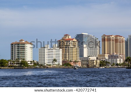 FORT LAUDERDALE, USA - AUG 1, 2010:skyline of Fort Lauderdale from the canal. The city is a tourist destination, with an average year-round temperature of 75.5 F and 3000 hours of sunshine per year.