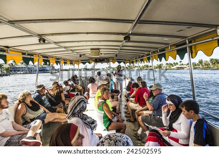 FORT LAUDERDALE, USA - AUGUST 20, 2014 : people travel in Water taxi in Fort Lauderdale, USA. Water taxi is popular by local people as well as by tourists. - stock photo