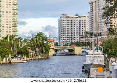 FORT LAUDERDALE, USA - DEC 6, 2015: New River with bridge, boats and apartment blocks in downtown Fort Lauderdale, Florida, USA - stock photo