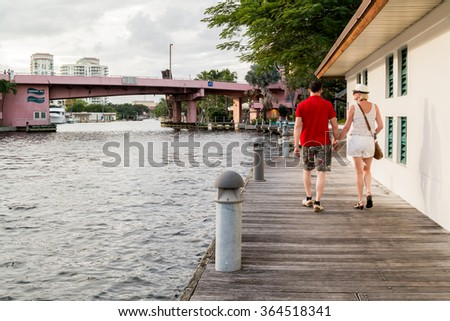 FORT LAUDERDALE, USA - DEC 6, 2015: People strolling on Riverwalk along New River in downtown Fort Lauderdale, Florida, USA - stock photo