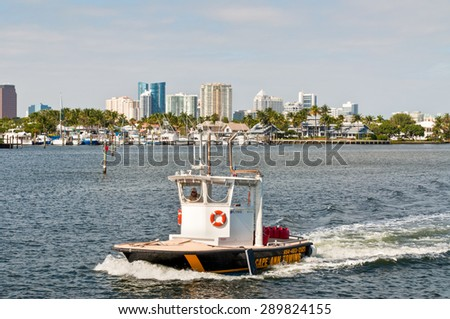 Fort Lauderdale, USA - December 8: Tow Boat sailing yacht towed to a place and salvage service on the New River, Florida at December 8, 2011. - stock photo