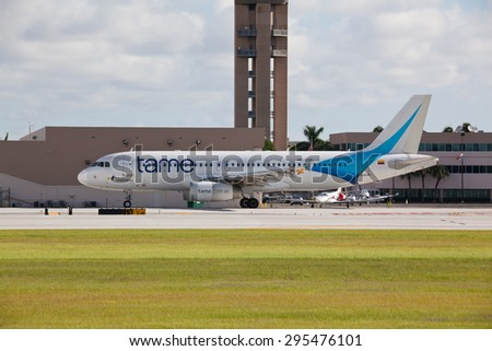 FORT LAUDERDALE, USA - JUNE 16, 2015: Airbus A320 jet airliner taxiing at the Fort Lauderdale/Hollywood International Airport. TAME is the national airline of Ecuador. - stock photo