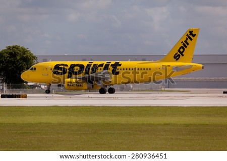 FORT LAUDERDALE, USA - May 24, 2015: A Spirit Airlines Airbus A320 taxiing at the Fort Lauderdale/Hollywood International Airport, Florida. Spirit Airlines has its operating base in Fort Lauderdale. - stock photo
