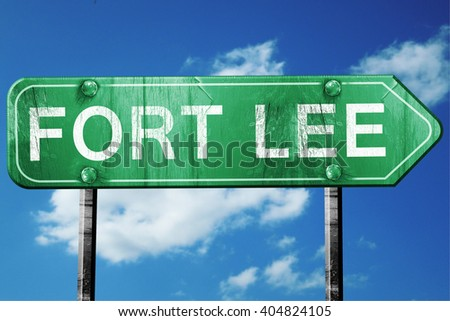 fort lee road sign , worn and damaged look