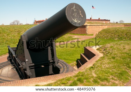 Fort McHenry National Monument and Historic Shrine with a cannon