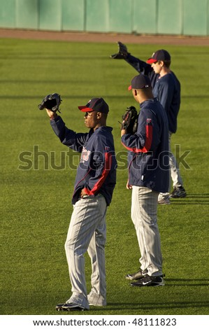 FORT MYERS, FLORIDA - MARCH 4: Minnesota Twins players participate in batting practice prior to a game against the Boston Red Sox on March 4, 2010 in Fort Myers, Florida - stock photo