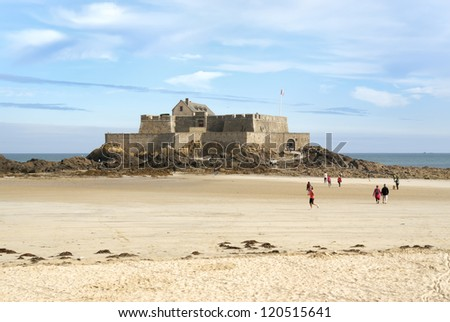 Fort National in Saint-Malo during low tide in the morning sunshine - stock photo