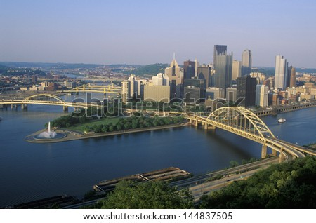 Fort Pitt Bridge over Allegheny River with Pittsburgh skyline, PA - stock photo
