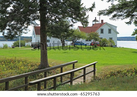 Fort Point Lighthouse and grounds, Stockton Springs, Maine - stock photo