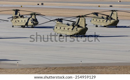 FORT RILEY, KS - FEBRUARY 8: Boeing CH-47 Chinook helicopters parked at Fort Riley, Kansas on February 8, 2015. Fort Riley is a United States Army Installation and home of the 1st Infantry Division. - stock photo