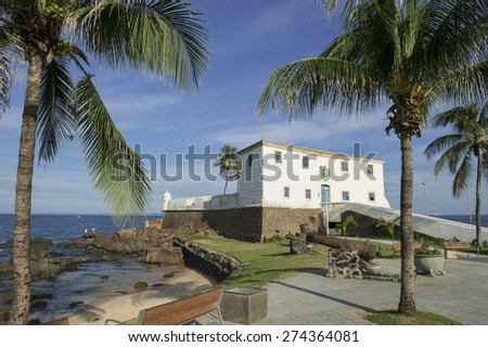 Fort Santa Maria in Barra Salvador Brazil featuring benches overlooking tropical beach and palm trees - stock photo