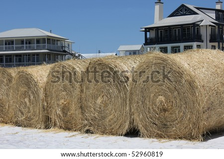 FORT WALTON BEACH, FL - MAY 9: Hay bales on white sand beach ready for BP oil spill cleanup May 9th, 2010, in Fort Walton Beach, FL. - stock photo