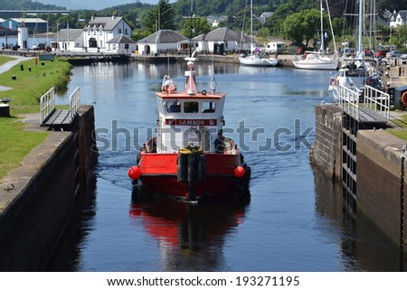 FORT WILLIAM, SCOTLAND - JULY 20: Neptune's Staircase lock on the Caledonian Canal, the longest staircase lock in Britain on 20 July 2013 in Fort William, Scotland, UK. - stock photo