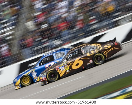 FORT WORTH, TX - APR 19: Kurt Busch and David Ragan race side by side at Texas Motor Speedway during the running of the Samsung Mobile 500 race Apr 19, 2010 in Fort Worth, TX. - stock photo