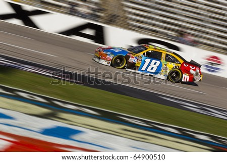 FORT WORTH, TX - NOV 06:  Kyle Busch brings his car through the frontstretch during a practice session for the AAA Texas 500 race on Nov 6, 2010 at the Texas Motor Speedway in Fort Worth, TX. - stock photo