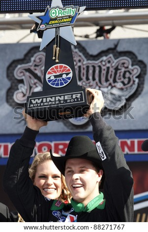 FORT WORTH, TX - NOV 05:  Trevor Bayne (16) wins the O'Reilly Auto Parts Challenge race at the Texas Motor Speedway in Fort Worth, TX on Nov 05, 2011.