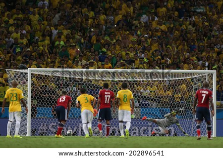 FORTALEZA, BRAZIL - JULY 04, 2014: Rodriguez of Colombia scores from penalty during the World Cup Quarter-finals game between Brazil and Colombia in the Estadio Castelao. NO USE IN BRAZIL. - stock photo