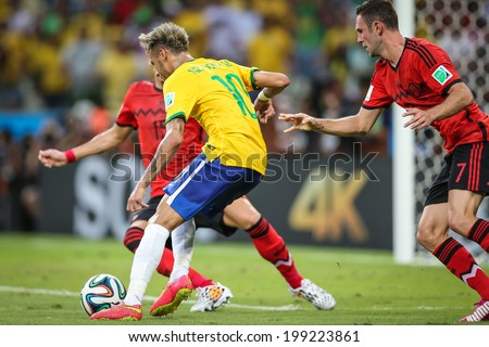 FORTALEZA, BRAZIL - June 17, 2014: Neymar of Brazil competes for the ball during the World Cup Group A game between Brazil and Mexico at Estadio Castelao. No Use in Brazil.