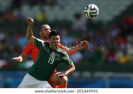 FORTALEZA, BRAZIL - JUNE 29, 2014: Peralta of Mexico and Vlaar of Netherlands during the World Cup Round of 16 game between the Netherlands and Mexico in the Castelao stadium.  NO USE IN BRAZIL.