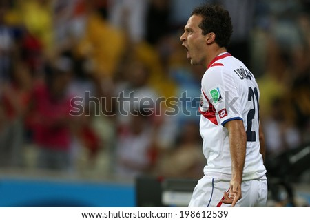 FORTALEZA, BRAZIL - June 14, 2014: Urena of Costa Rica celebrates after scoring a goal during the 2014 World Cup Group D game between Uruguay and Costa Rica at Castelao Stadium. No Use in Brazil.
