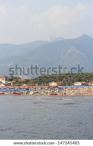 Forte dei Marmi beach and Apuane alps, Italy - stock photo