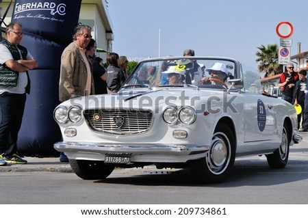 FORTE DEI MARMI, ITALY - APRIL 26: A white Lancia Flavia Convertibile takes part to the GP Terre di Canossa classic car race on April 26, 2014 in Forte dei Marmi. The car was built in 1964. - stock photo