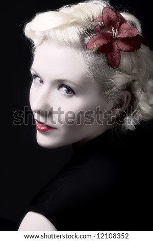 Forties hollywood a beautiful woman stares back. Minimal lighting and strong contrast - stock photo